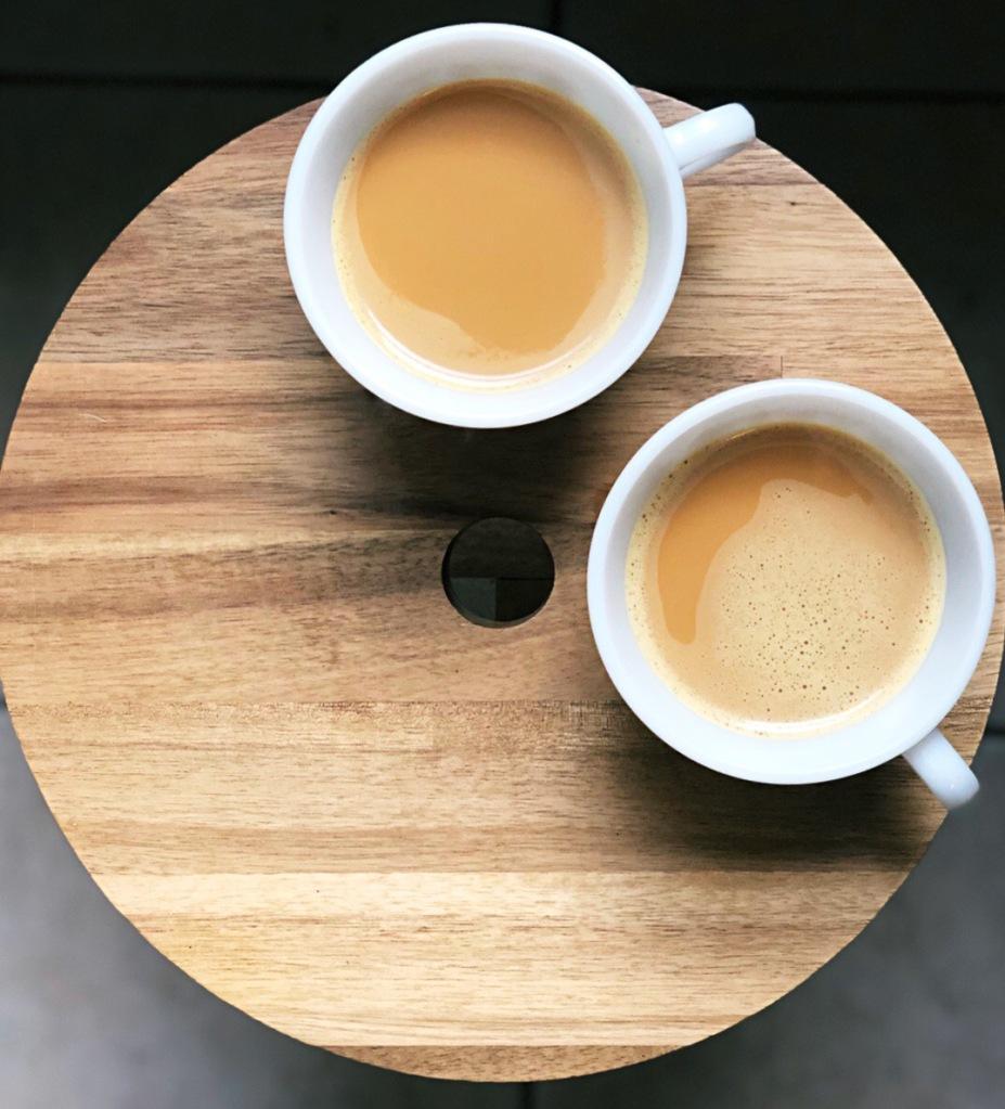 Turmeric chai lattes in pyrex tea cups on an Ikea stool